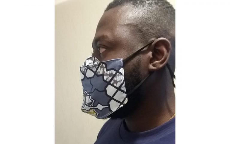 Reusable, designer West African print face masks PPE by L'Addae - 'Tribal' design (side view)